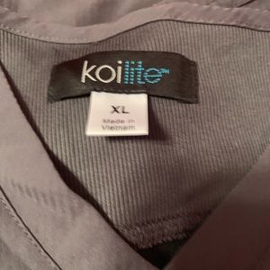 Kiolite scrub top large. One large and 2 xl